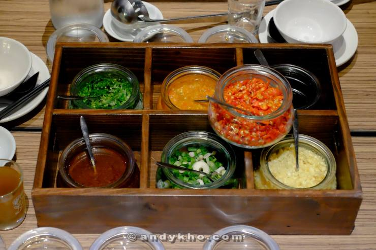 The variety of condiments and sauces to go along with the meal